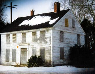 Windham House, C 1800, an overhung, center hall, measuring 27' x 36' twin chimney dwelling has an original ell.